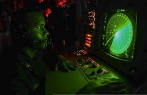 Navy Specialist 2nd Class Dennis Rivera monitors a radar console in the Persian Gulf during the summer of 2013. (Photo: Billy Ho, U.S. Navy)